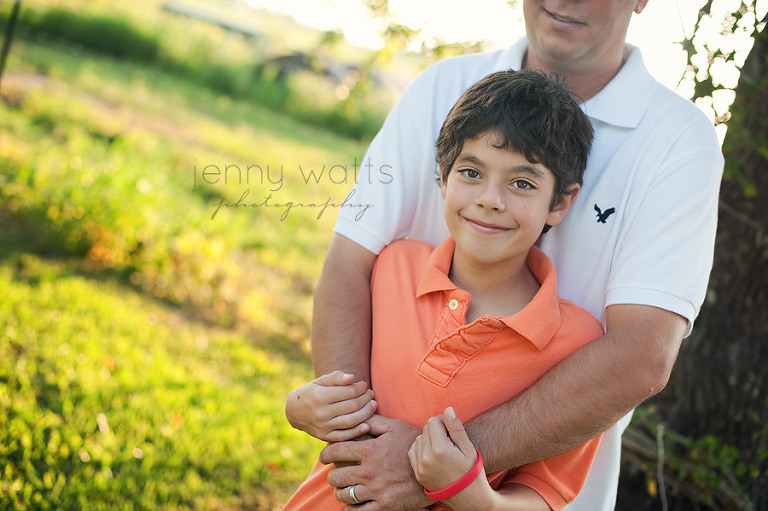 father and son on a farm at sunset