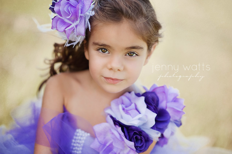young girl with gorgeous eyes dressed up in purple frilly outfit