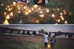 siblings laughing in the grass by candle light at white rock lake