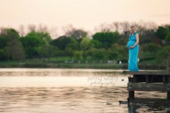 beautiful maternity session lakeside at sunset with mom on dock
